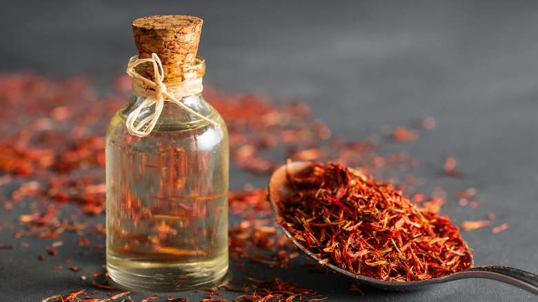 a glass jar gilled with saffron and oil