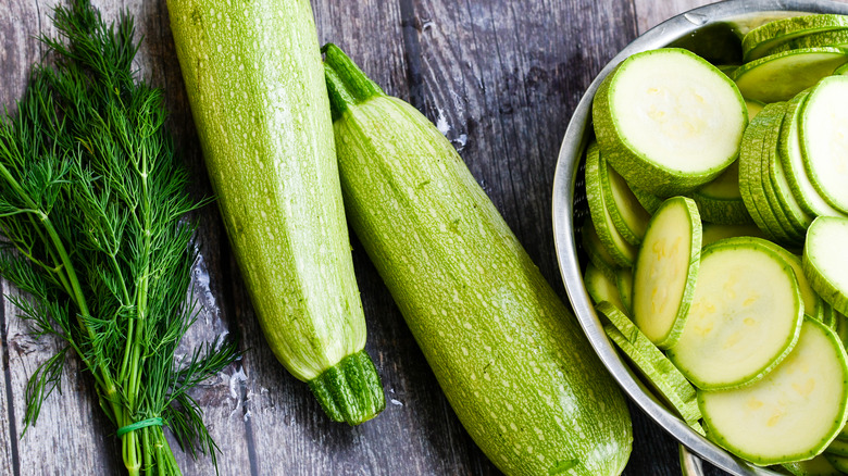 Whole and sliced zucchini