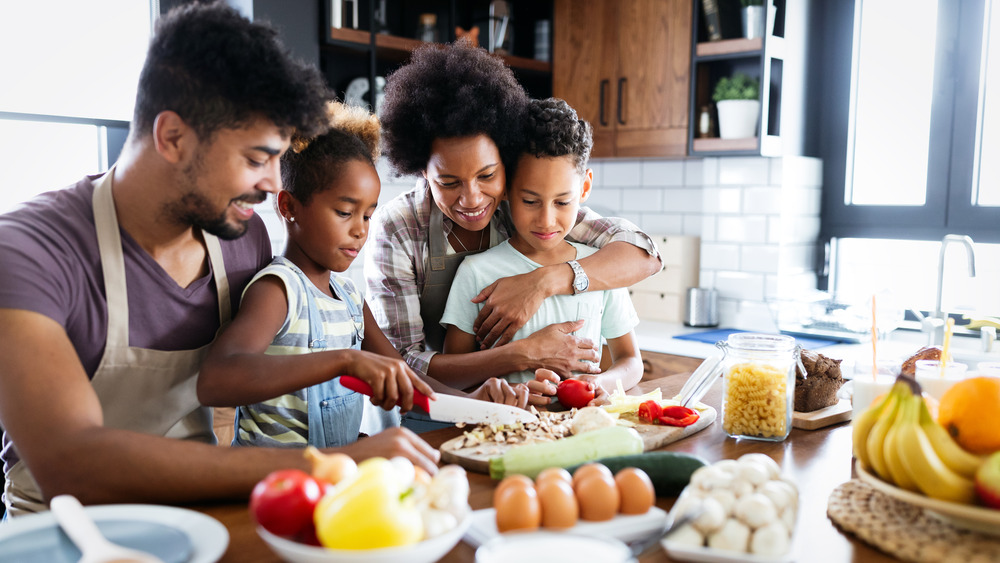 Family with children cooking together