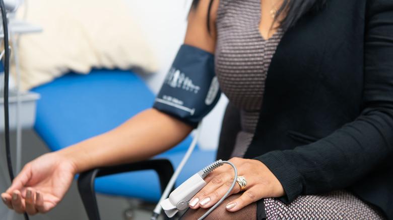 Woman has her blood pressure taken