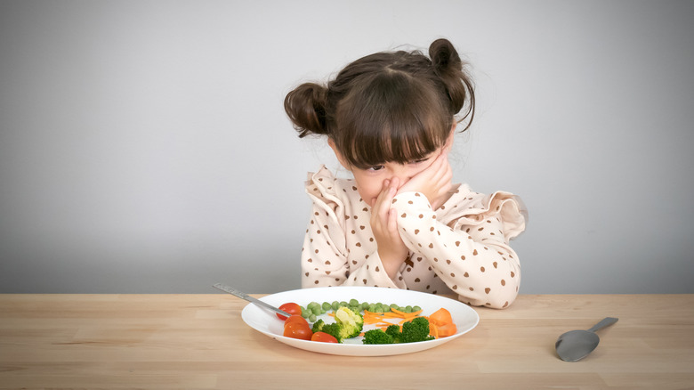 A child is being picky about their food