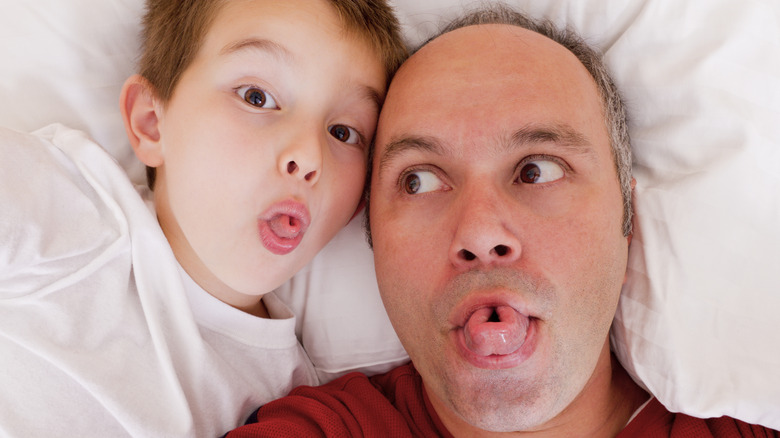 Father and son both rolling their tongues