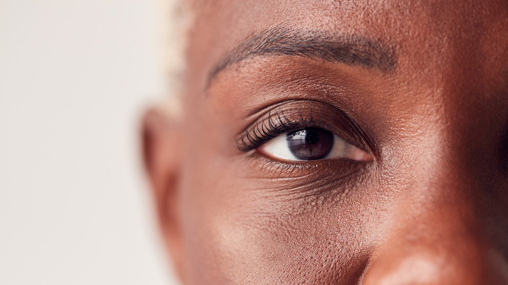 Close up of a woman's upper right face focused on her eye