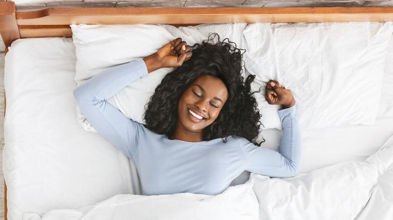 Woman sleeping alone happily