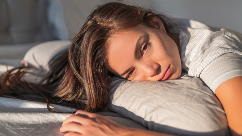 Woman sleeping with eyes open