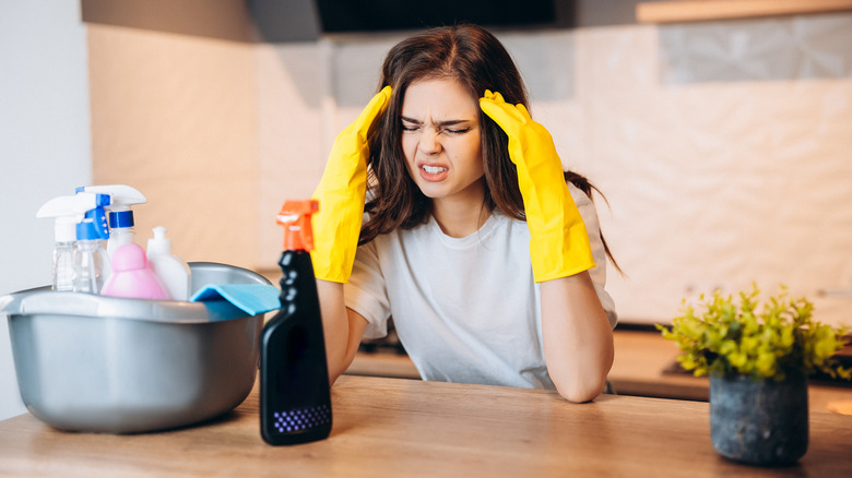 woman gets headache while cleaning
