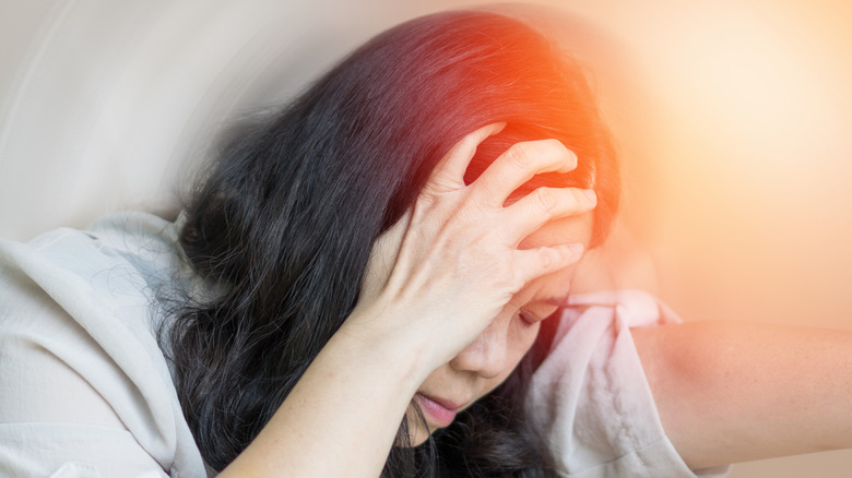 woman with a migraine