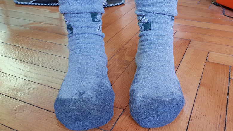 Two feet with sweaty blue socks