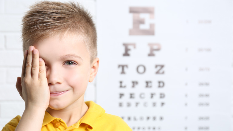 Boy taking eye exam