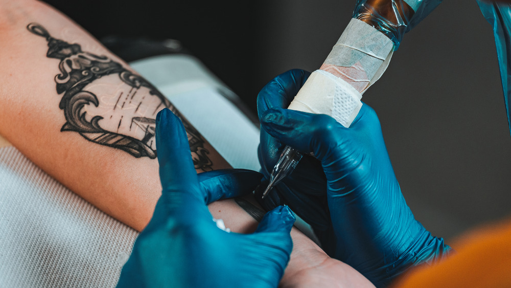 Close up of person getting a tattoo