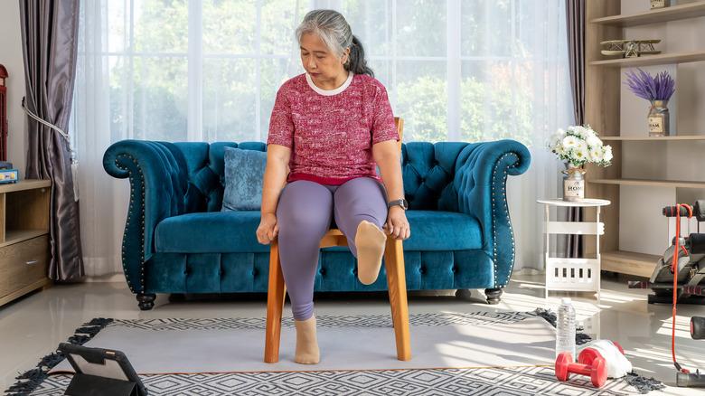 Woman doing single-seated leg raises
