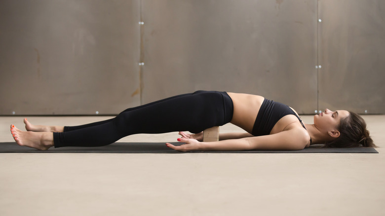 woman on yoga block