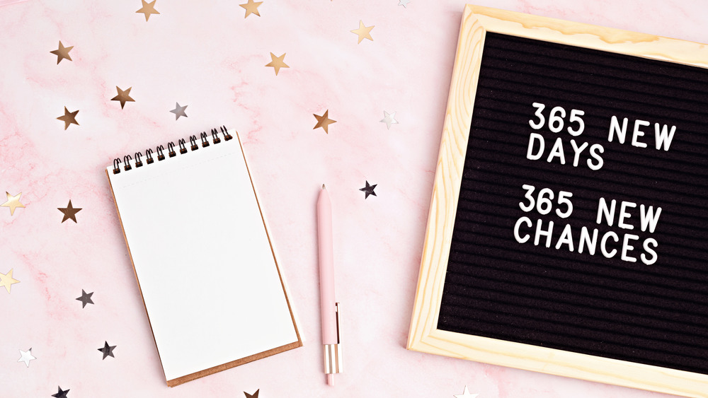 New Year's sign and notebook