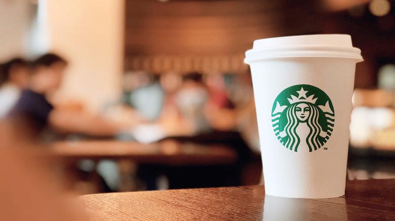 Starbucks cup on table