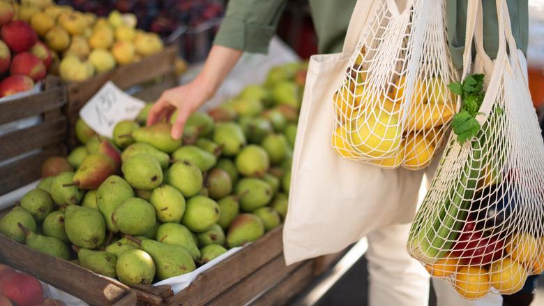 Woman picking fruit at farmer's market