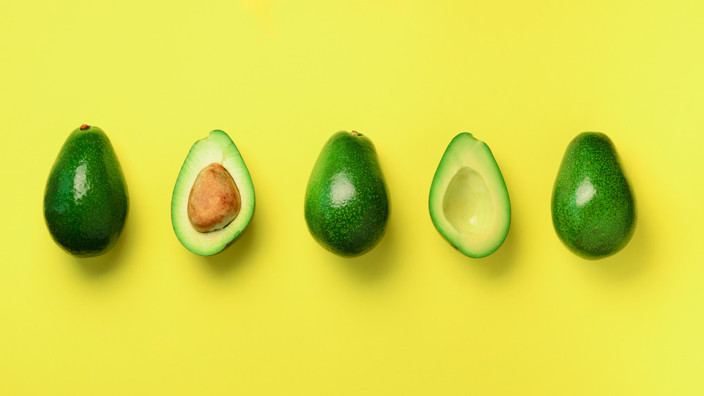 Avocados on a yellow background