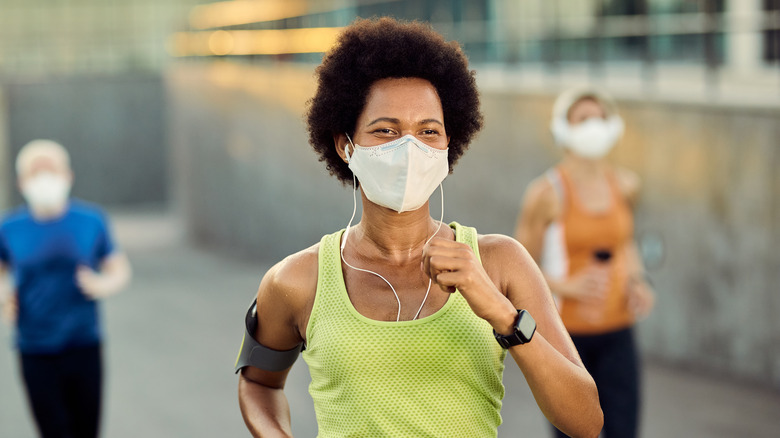 woman running in mask