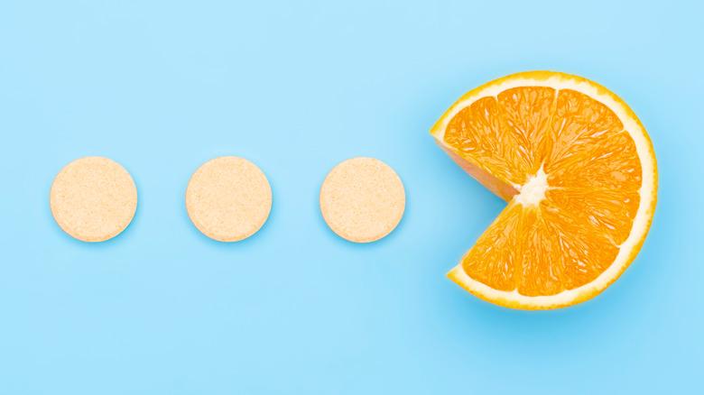 Vitamin C supplements with C-shaped orange