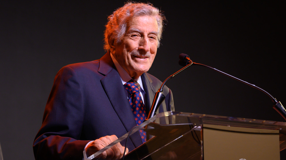 Tony Bennett standing at a lectern
