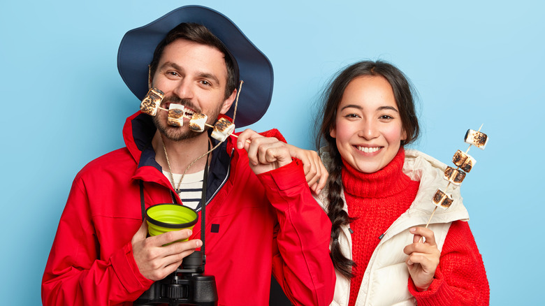 couple eating toasted marshmallows