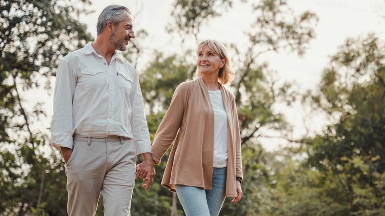 couple in 50s walking outside