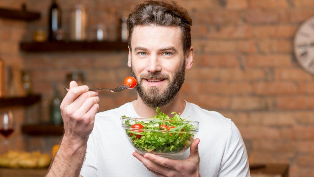 man eating vegan salad