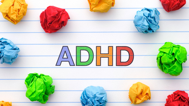 ADHD written in colorful letters and surrounded by tufts of colored paper