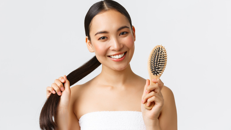 Woman holding a hair brush