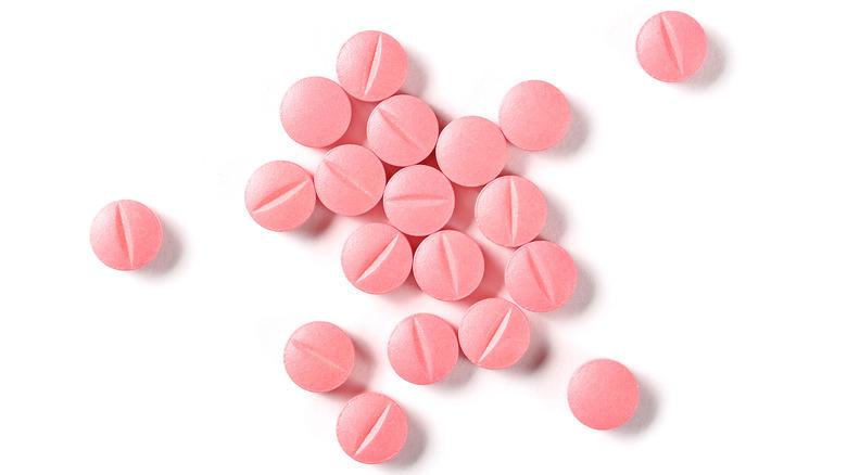 A close up of little pink pills