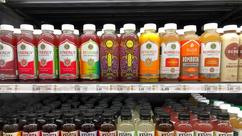 Bottles of kombucha in a grocery store