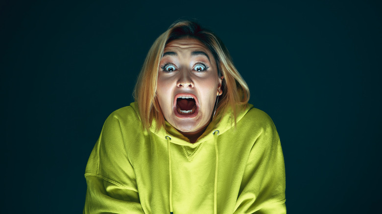 A scared woman screaming