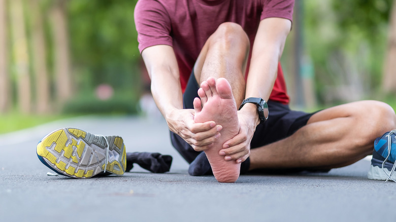 Man with athlete's foot rubbing his foot