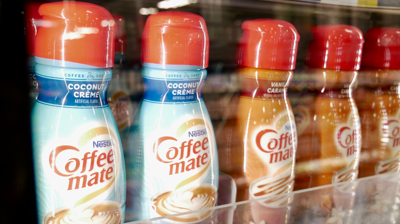 Several bottles of coffee creamer in a store
