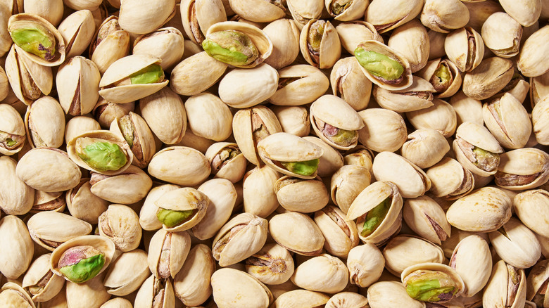 A large pile of pistachios