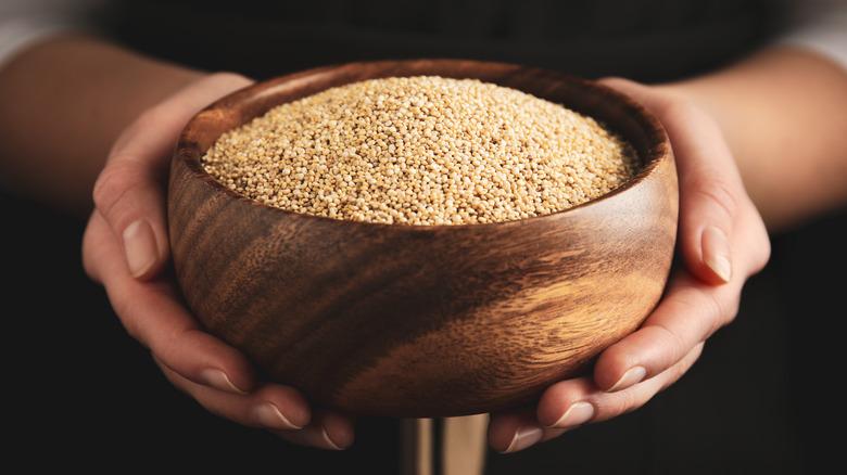 woman holding quinoa