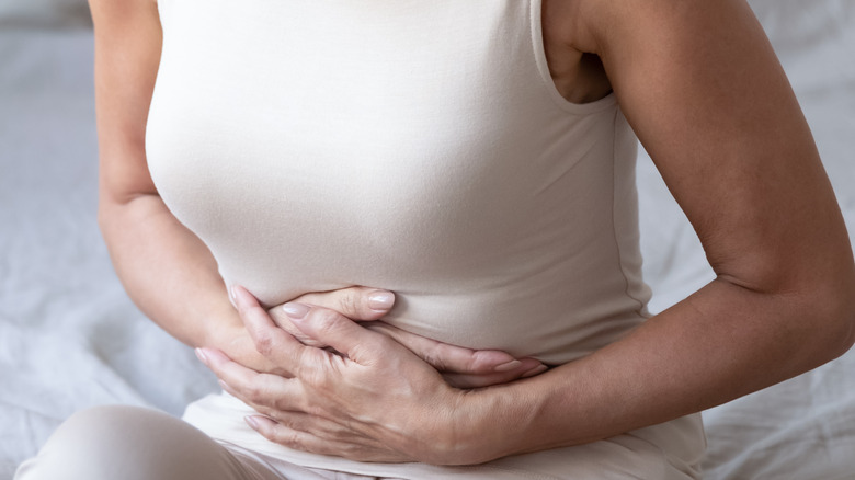 woman holding her stomach
