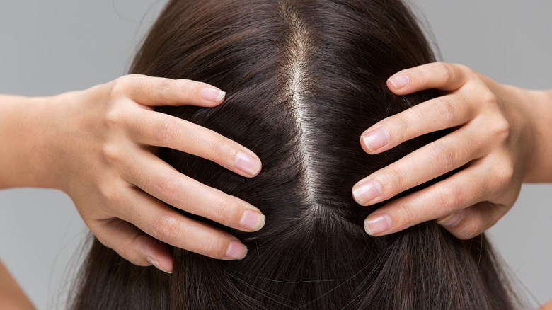 Woman showing part in her hair without dandruff