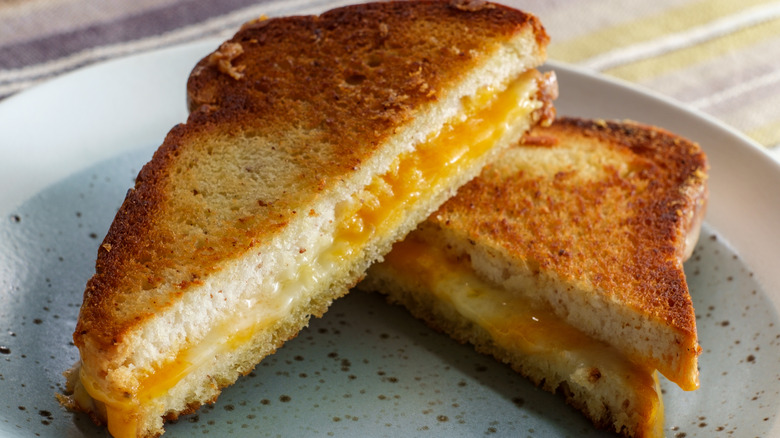 sliced grilled cheese sandwich made with American cheese