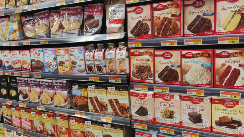 selection of boxed cake mixes in the grocery aisle