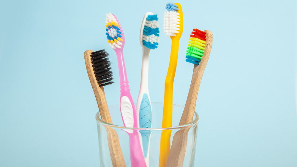 Set of toothbrushes in glass