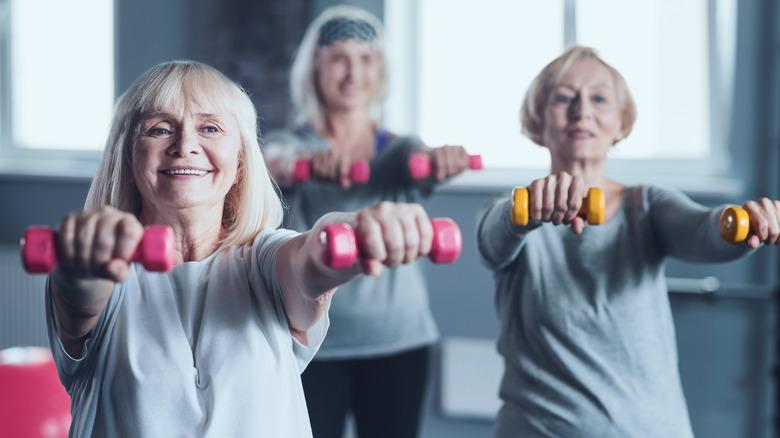 mature women lifting weights