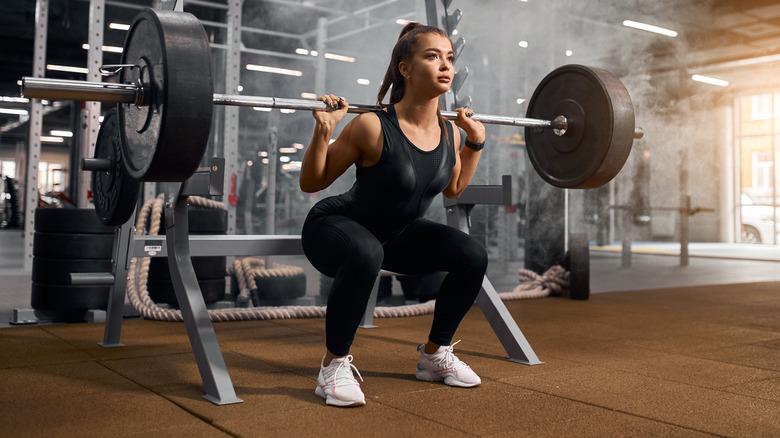 Woman doing back squat