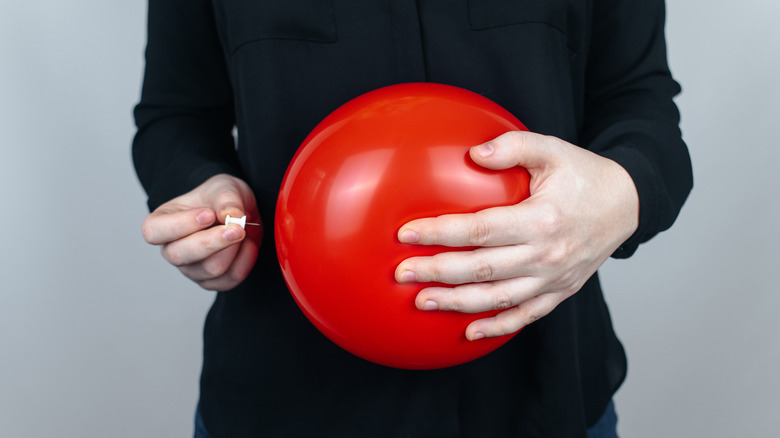 Red balloon, symbolizing a bloated tummy