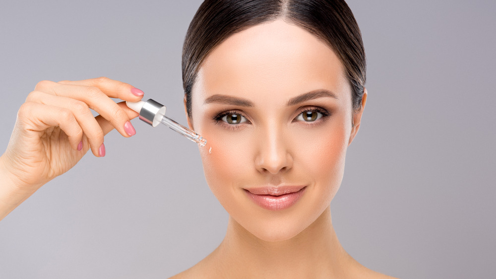 woman using retinol for healthier younger skin