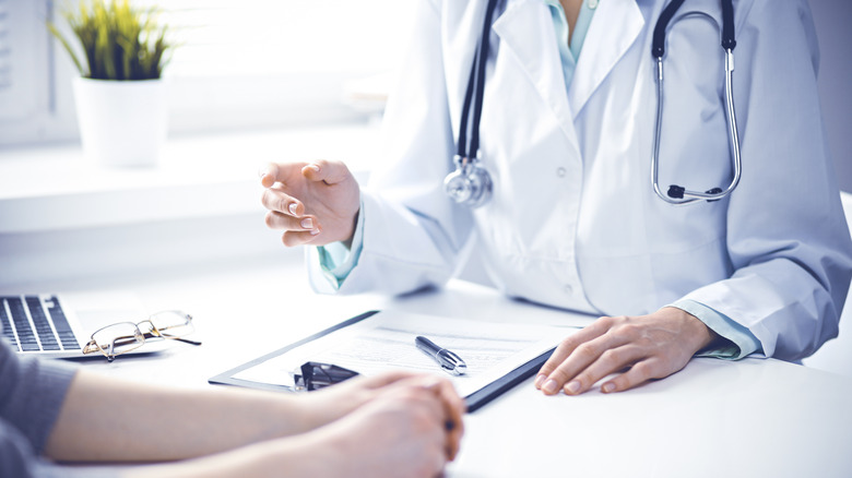 woman talking with doctor