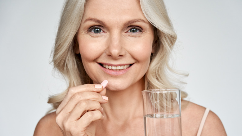 woman taking supplement
