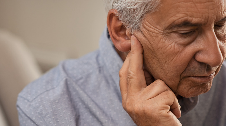 Older man with hearing loss