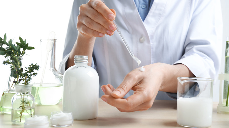 A dermatologist in the testing phase of a new lotion