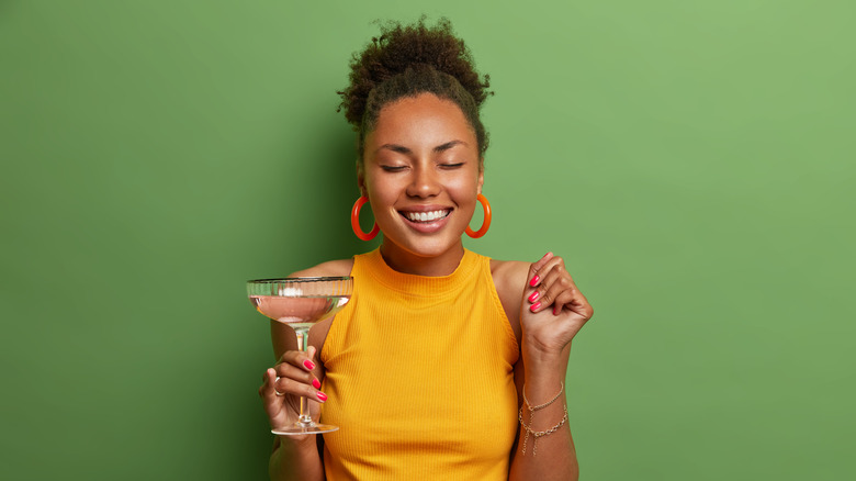 woman with cocktail in hand