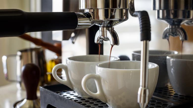 coffee being prepared in an espresso machine